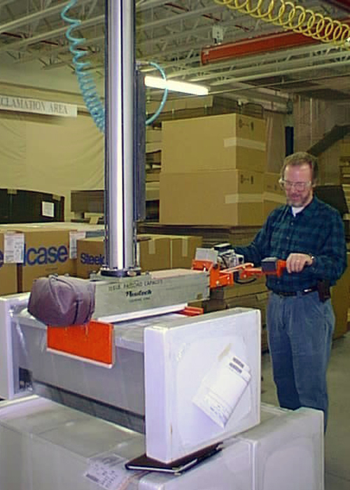 Simple Air Manipulator is an overhead mounted lift arm shown installing a seat