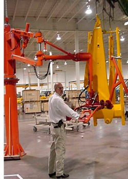Taurus hydraulic manipulator shown with an end effector loading a paint line
