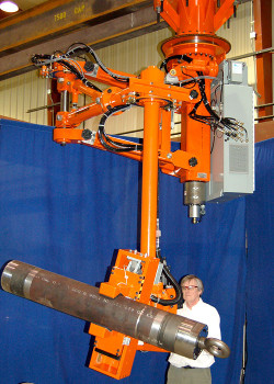 Taurus overhead mounted manipulator arm shown with an OD gripper