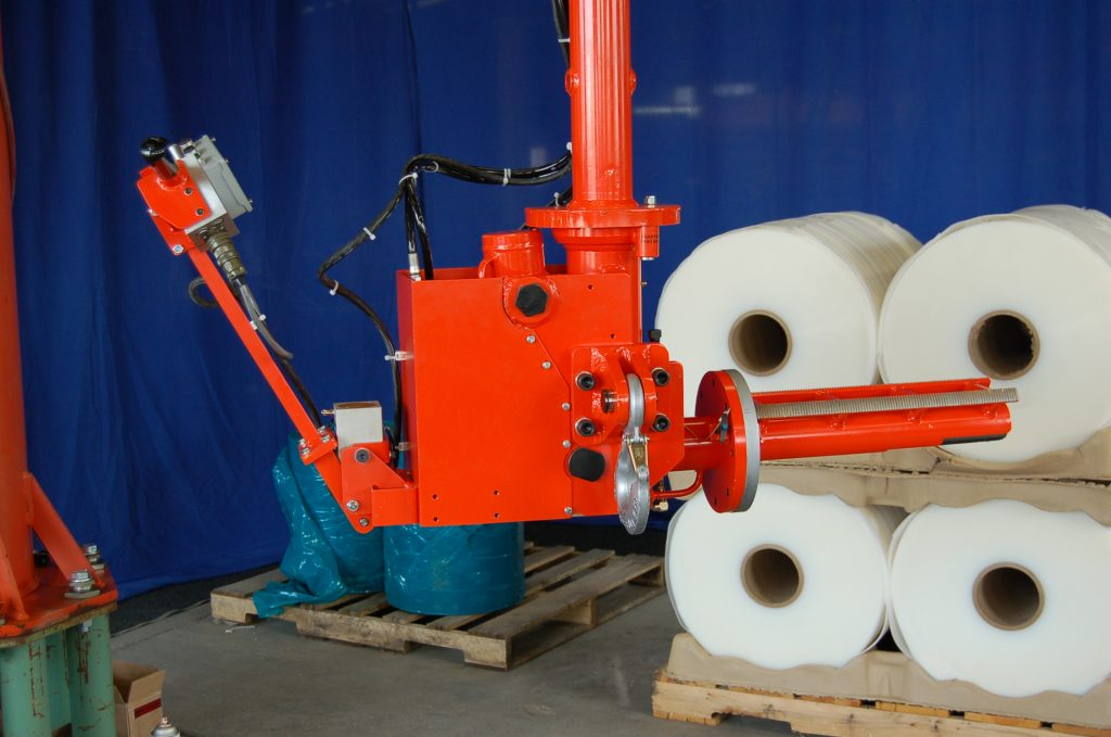 Expanding Mandrel roll lifter with pitch to move a roll from vertical to horizontal